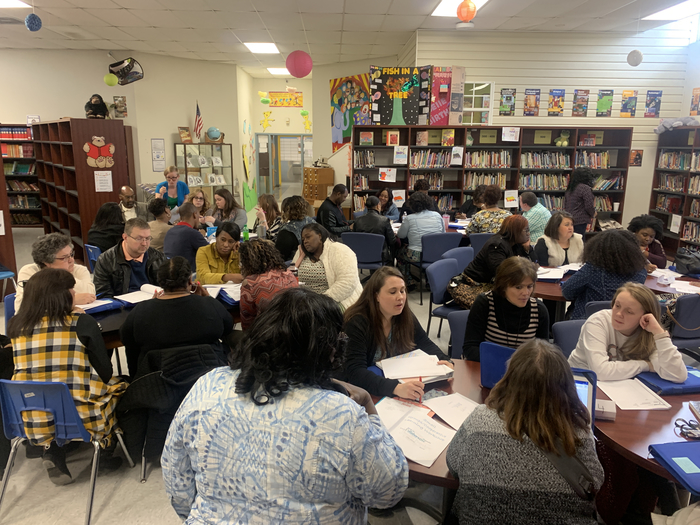 Teachers engaged in small groups/cooperative learning workshop